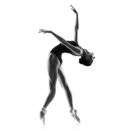 beautiful woman ballet dancer isolated on studio white background